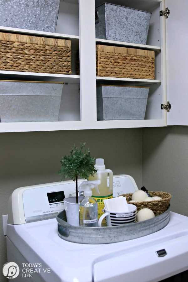 organizing baskets in a laundry room
