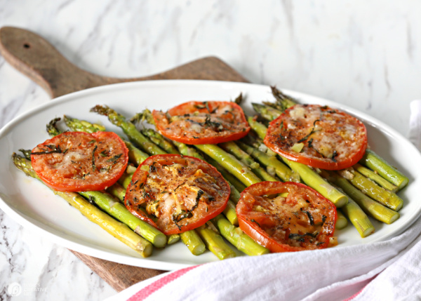 Roasted tomatoes and asparagus on serving platter