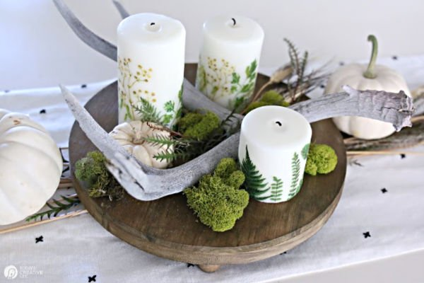 Table Centerpiece with Candles that ferns on them