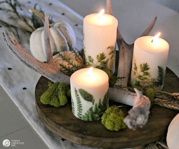 Candles lit in fall table centerpiece.