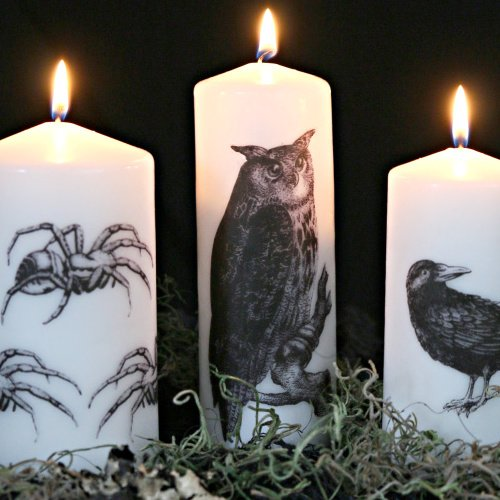 white candles with halloween images