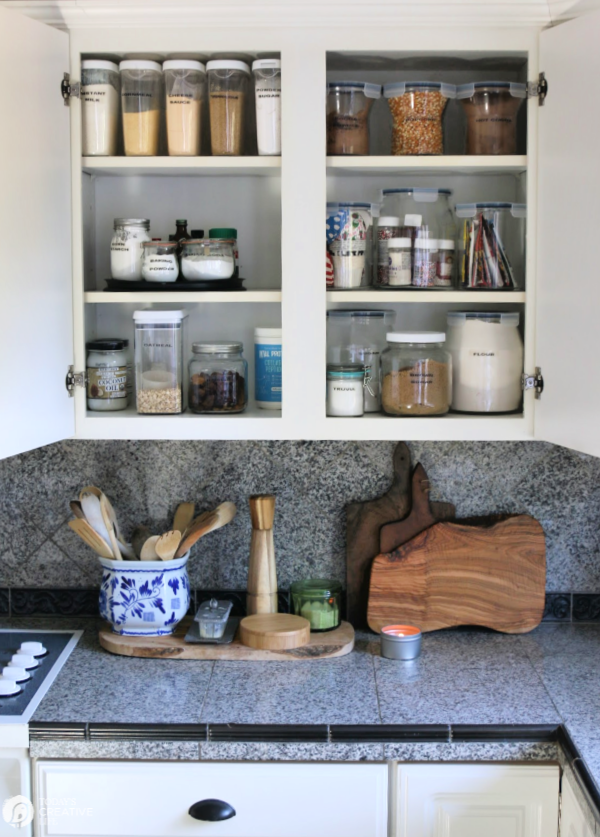 Open kitchen cabinets with food storage
