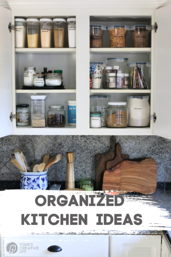 Kitchen cabinet full of organized pantry items