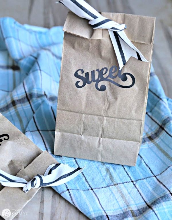 Paper sack with Sweet written on it. Tied with ribbon