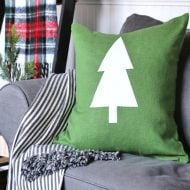 Green holiday pillow with white tree