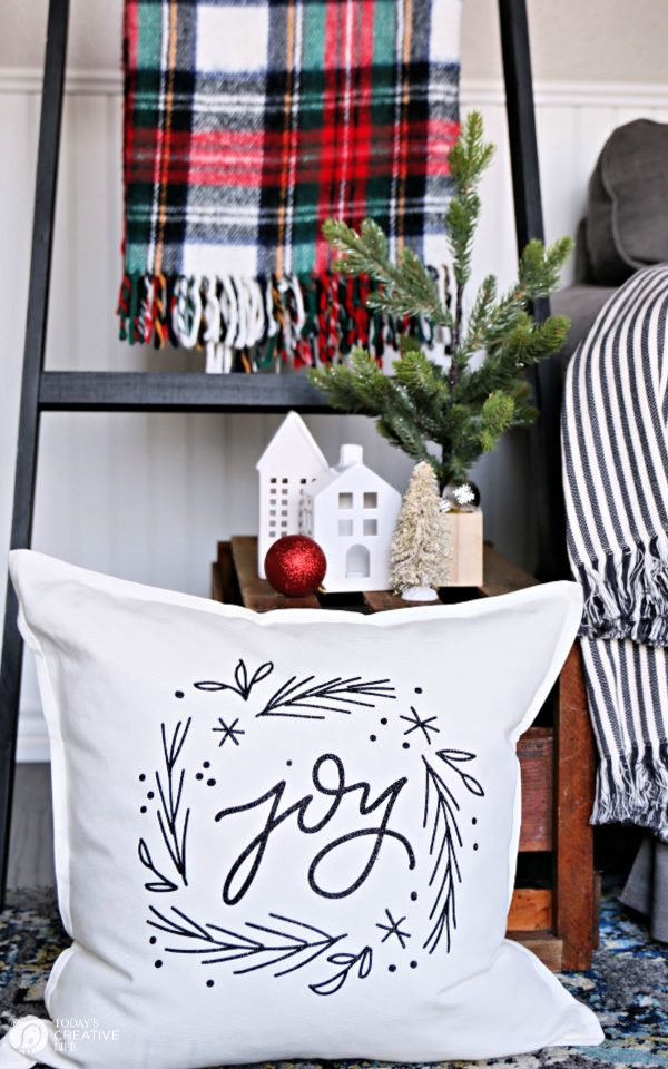 Christmas decorations with pillow, plaid blanket and nicknacks.