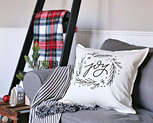 White Pillow with JOY written on it.