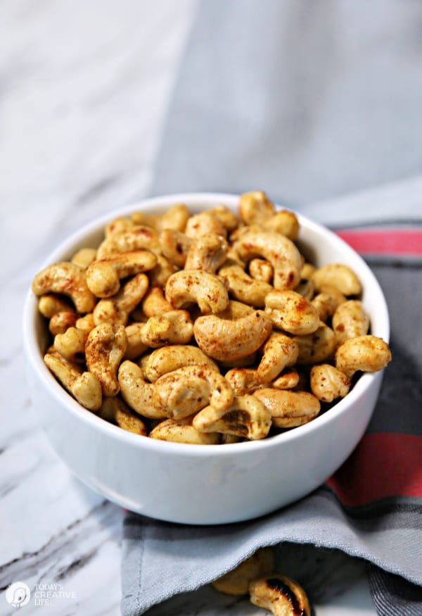 Spiced cashews in a white bowl