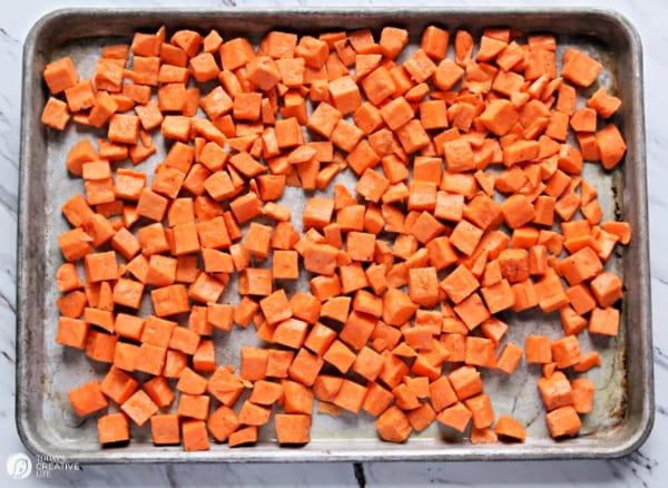 baking pan filled with cubed sweet potatoes