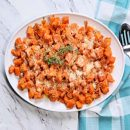 White platter with cubed roasted sweet potatoes