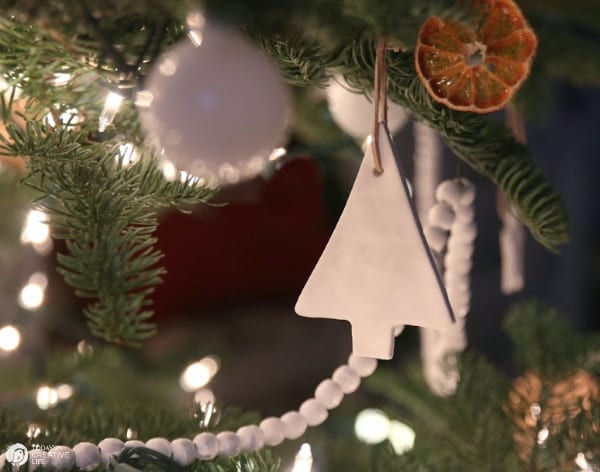 White Tree Clay Ornament hanging on Christmas Tree