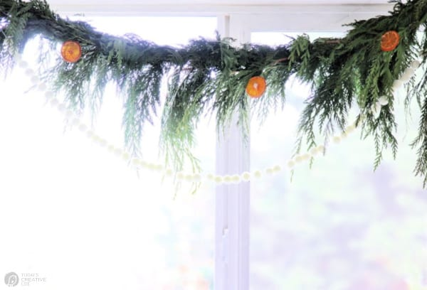 Cedar Garland with dried oranges and pompom garland
