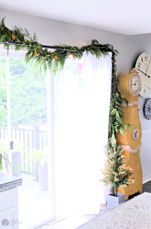 Decorated Sliding glass door decorated with cedar garland.