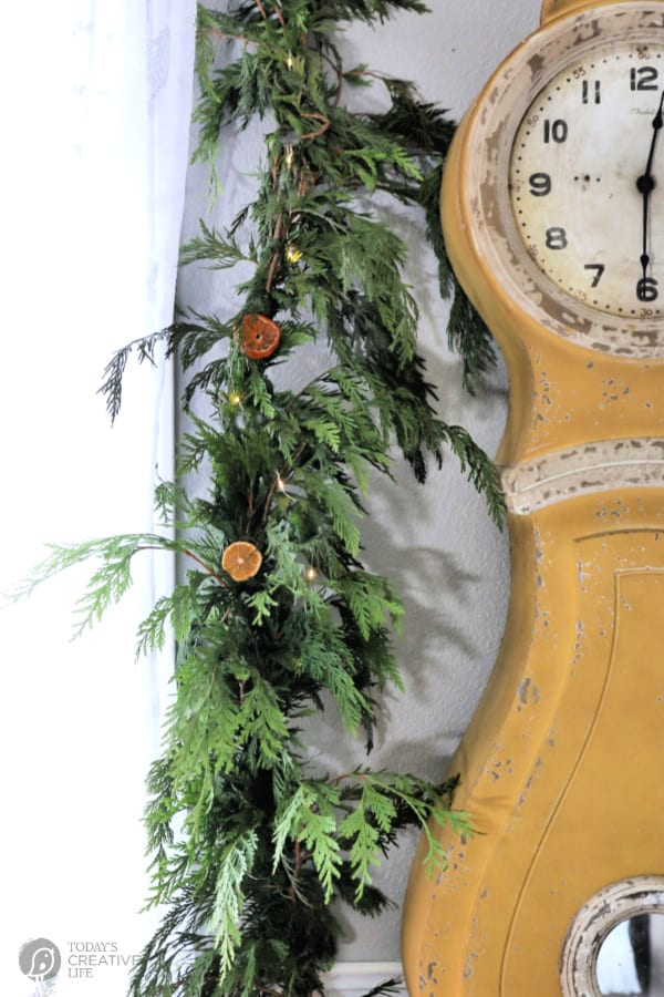 Gold Swedish Clock with Cedar Garland and Dried Oranges.