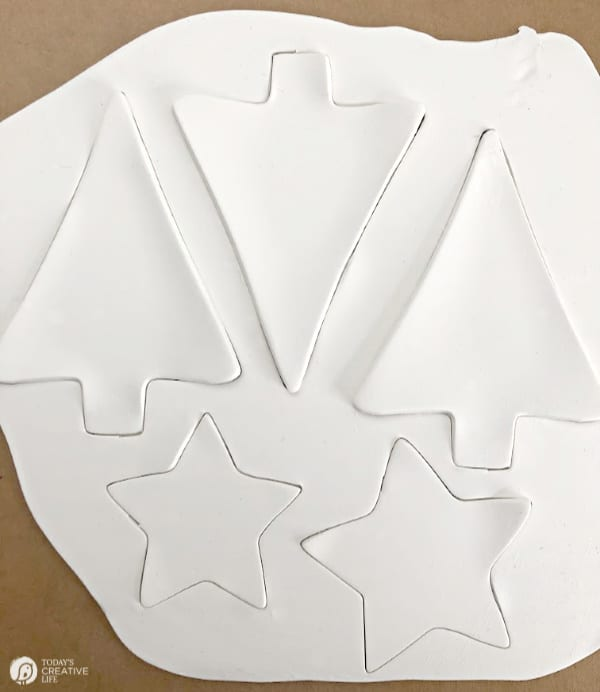 Rolled out white clay with cut shapes