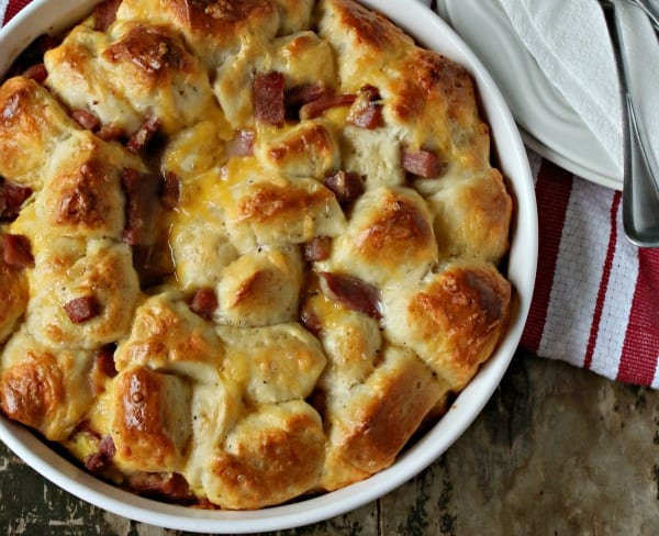 overhead view of a breakfast casserole with biscuits and ham