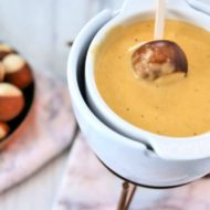 Cheese fondue with dipping pretzel