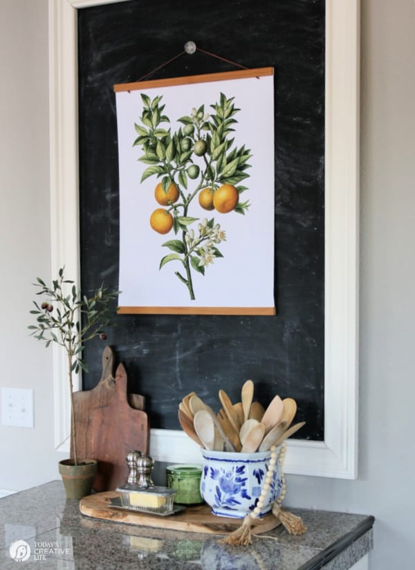 Kitchen chalk board with botanical poster.