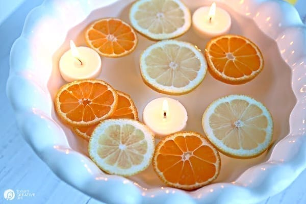 floating sliced citrus with candles