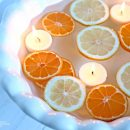 sliced floating lemons and oranges