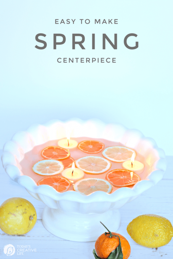 large bowl with water and floating sliced lemons with floating candles
