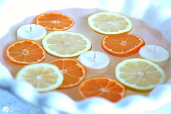 Sliced citrus floating in a bowl of water