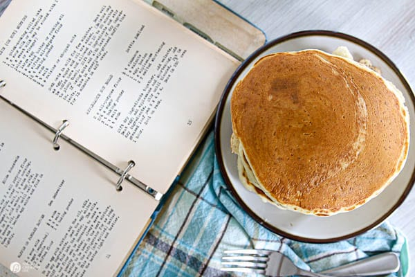 overhead shot of pancakes and a recipe book