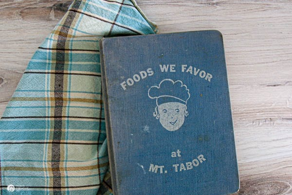 Blue cookbook with dishtowel