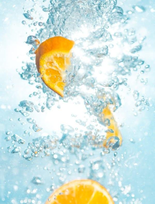 sliced oranges in water