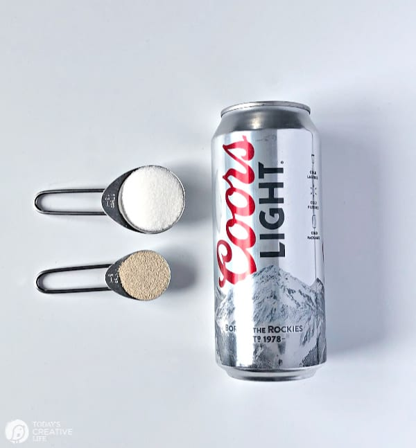 Can of Beer with sugar and yeast in measuring spoons
