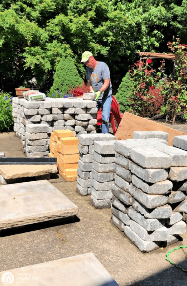Stacks of stone and bricks for building an outdoor fireplace