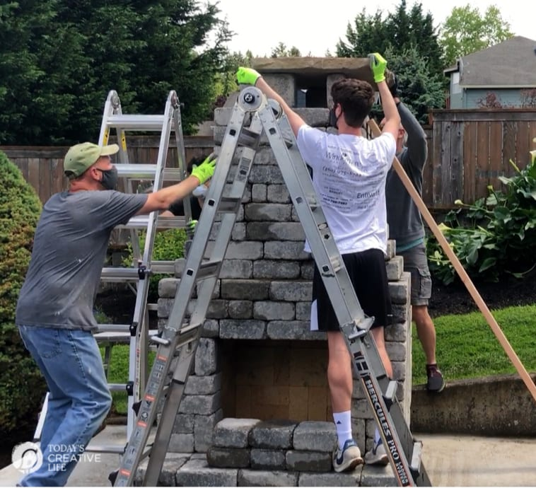 Men building an outdoor fireplace