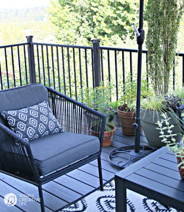 Grey patio furniture with deck railing in the background.
