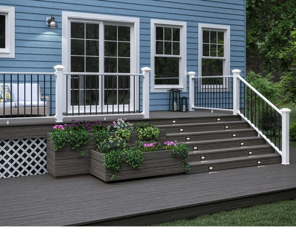 Blue house with white deck railing