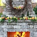 outdoor stone fireplace with fall mantel