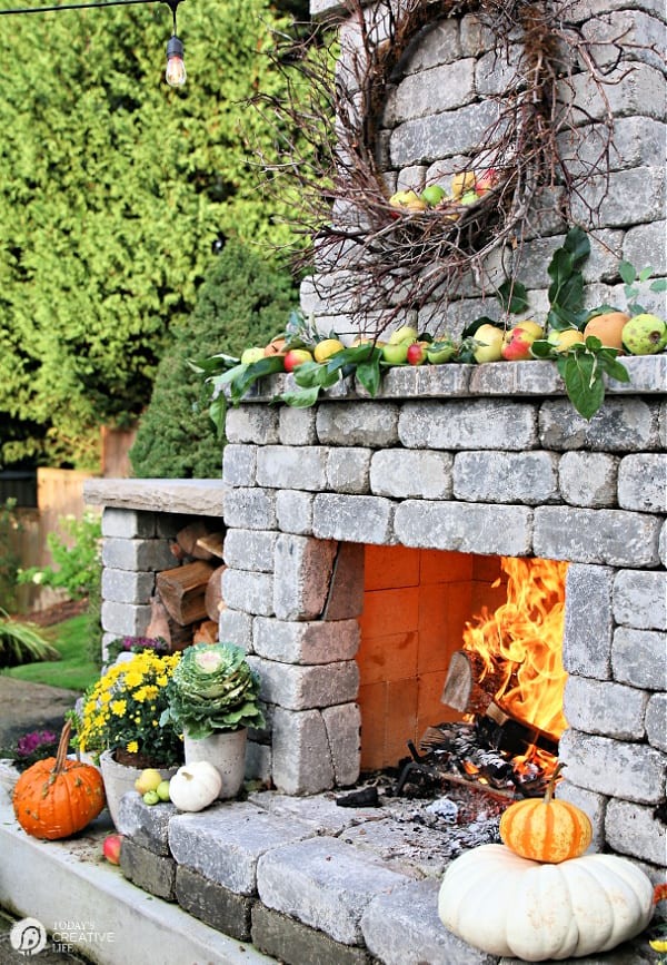 Outdoor stone fireplace decorated for Fall