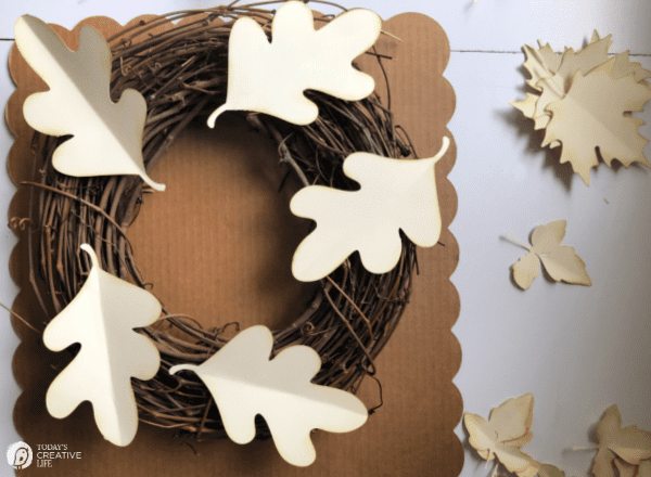 Paper leaves laying on a grapevine wreath