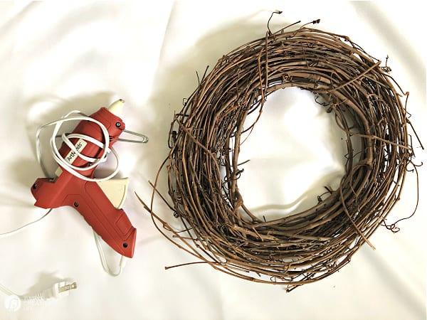 Supplies for crafting. Grapevine Wreath and a Glue Gun