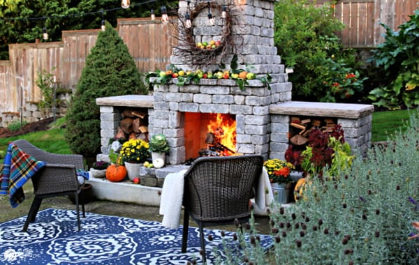 Decorating Ideas for Fall with an outdoor fireplace.