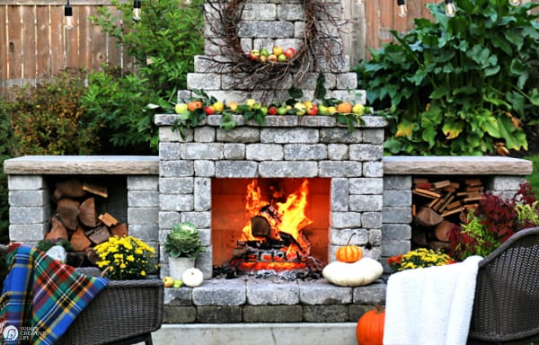 Rustic Outdoor Fall Decorating Ideas with an outdoor fireplace