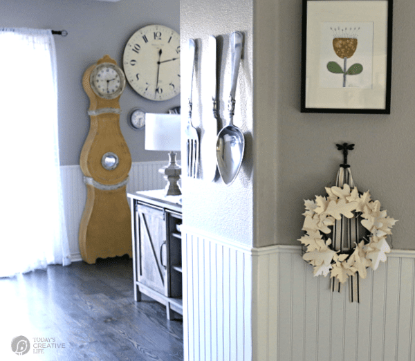 A view of a fall decorated home with a hanging diy paper leaf wreath
