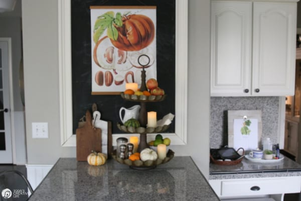 Kitchen decorated for Fall with botanical pumpkin poster