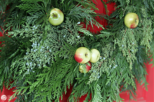 green cedar wreath with apples.