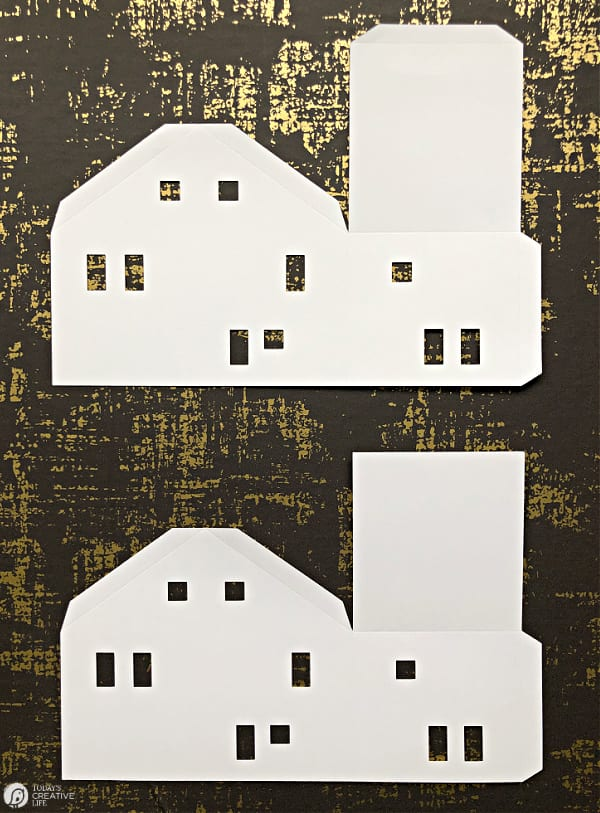 2 cut out paper house templates, ready to fold.