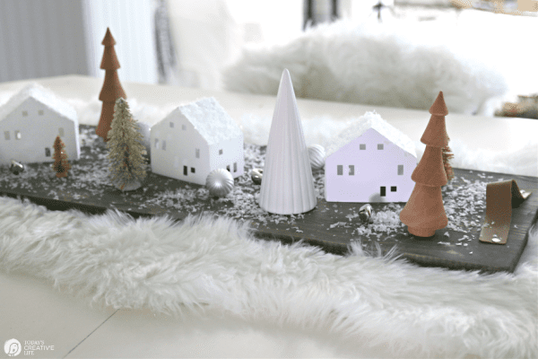 Christmas table centerpiece with wood trees and DIY paper houses