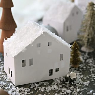 white paper house with faux snow on top.
