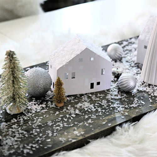white paper house in a table centerpiece for Christmas