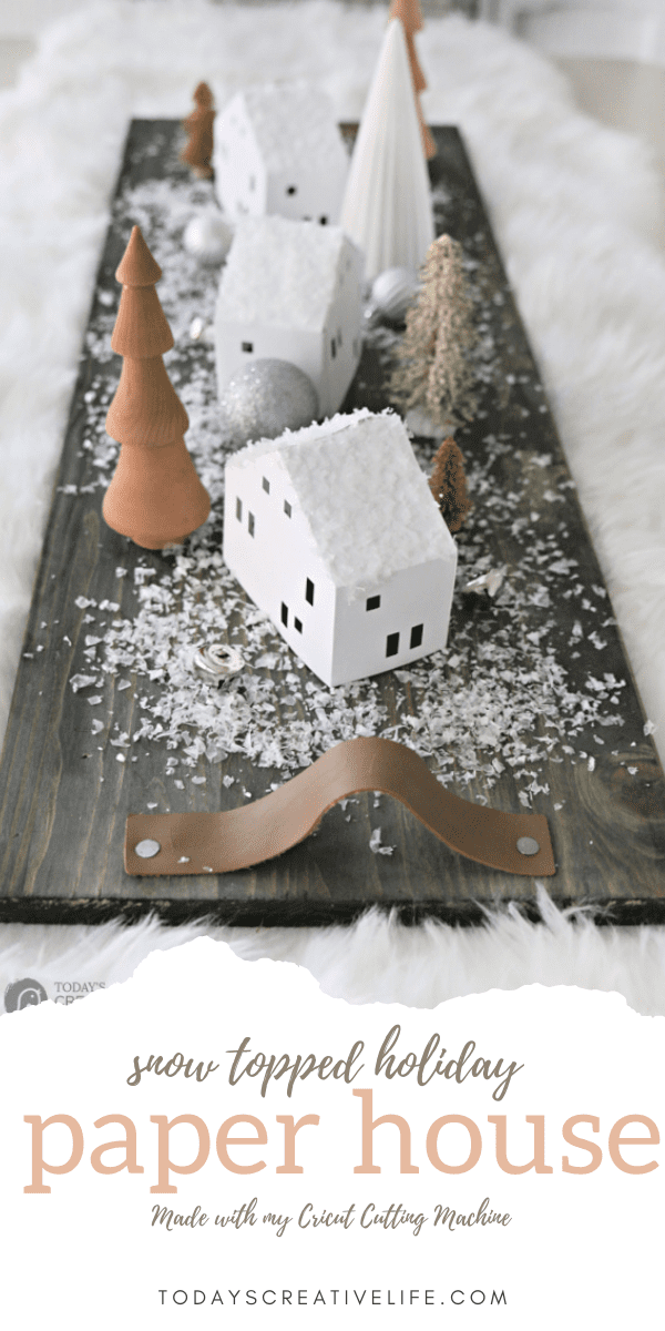 Photo Collage of christmas decor with paper houses.