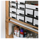 Organized craft closet with containers and labels