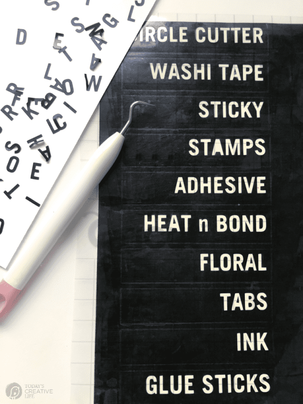 Black Labels with white writing to organize a craft room